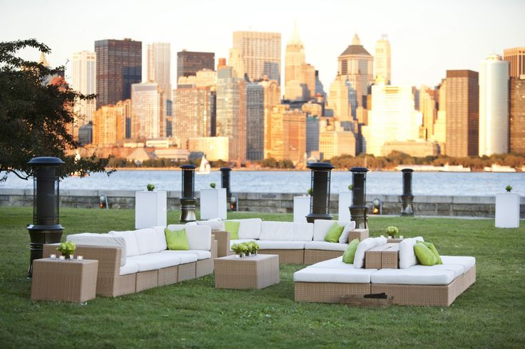 LOVE this outdoor cocktail party seating arrangement at an Ellis Island wedding. Look at that view!