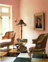 Portraits with rich tones work well against soft pink walls.