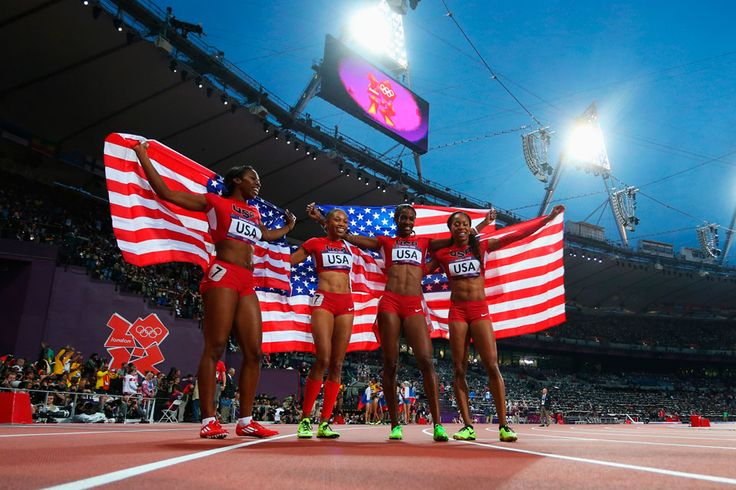 London 2012 - From left to right, Francena McCorory, Allyson Felix, DeeDee Trotter, and Sanya Richards-Ross celebrate victory after winning gold for the USA during the women's 4x400M relay on August 11, 2012.  2012 Getty Images