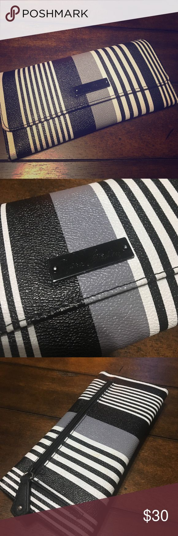Vera Bradley Wallet Beautiful black/white/gray stripe Vera Bradley wallet. Magnetic closure. One external zipper pocket. Inside there are 11 card slots, 2 ID windows, 3 full length pockets. Excellent pre loved condition. Vera Bradley Bags Wallets