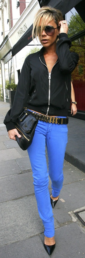 Channel Victoria Beckam's bad girl vibe by adding a dark embellished belt to your outfit.