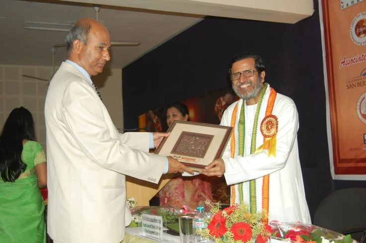 Receiving honorary plaque at International Conference on Spirituality and Management at School of Management Science, Varanasi, India
