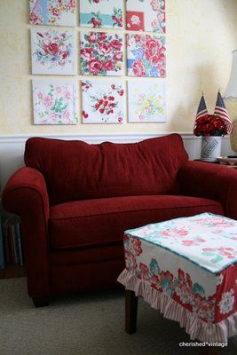 Attach your favorite fabric pieces to quilting hoops, frames or mats and hang on your wall. Then make a footstool slipcover in matching fabric to bring it all together. I love this simple decorating idea.