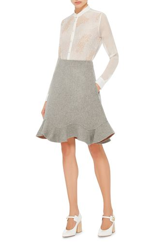 This **Mary Katrantzou** skirt features a double face wool construction with a flared shape and a ruffled hem.