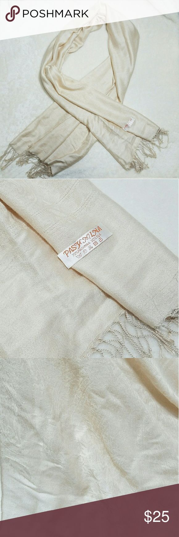Pashmina Cream Luxurious Long Pashmina Scarf -Good used condition- a few pulls in the fabric (see last two photos)  -Subtle paisley design in the woven construction -Thread tassles on each end Please use measurements for size reference, all measurements are taken laying flat: -Length 6.5' -Width 2.25' -70% Pashmina  -30% Silk -Cream beige (colors' appearance may vary on screen)  Questions? Just ask! Bundle to save!  Offers welcome  Happy Poshing! Pashmina Accessories Scarves & Wraps