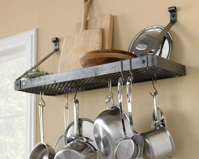 I love the Enclume Deep Shelf Pot Rack on Williams-Sonoma.com ... one day in my kitchen I think I would love something like this