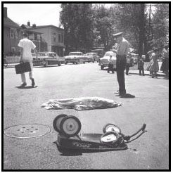 1959 - Award heartbreaking photograph which shows the death of a child in the street, while playing with his scooter. Taken by William Seaman for Minneapolis Star