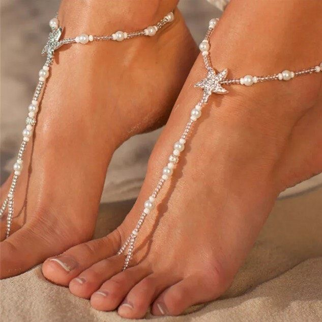 Starfish and pearls barefoot sandals bridal foot jewelry by Enchanted Ornaments This is a gorgeous faux pearls and starfish barefoot beaded anklet to wear on your special wedding day. Great for your destination weddings on the beach. Barefoot sandals are an one foot thong, toe ring, & anklet, very stylish and an elegant way to accessorize your feet ¨C with the beauty and freedom of being barefoot.Can be worn with or without shoes.