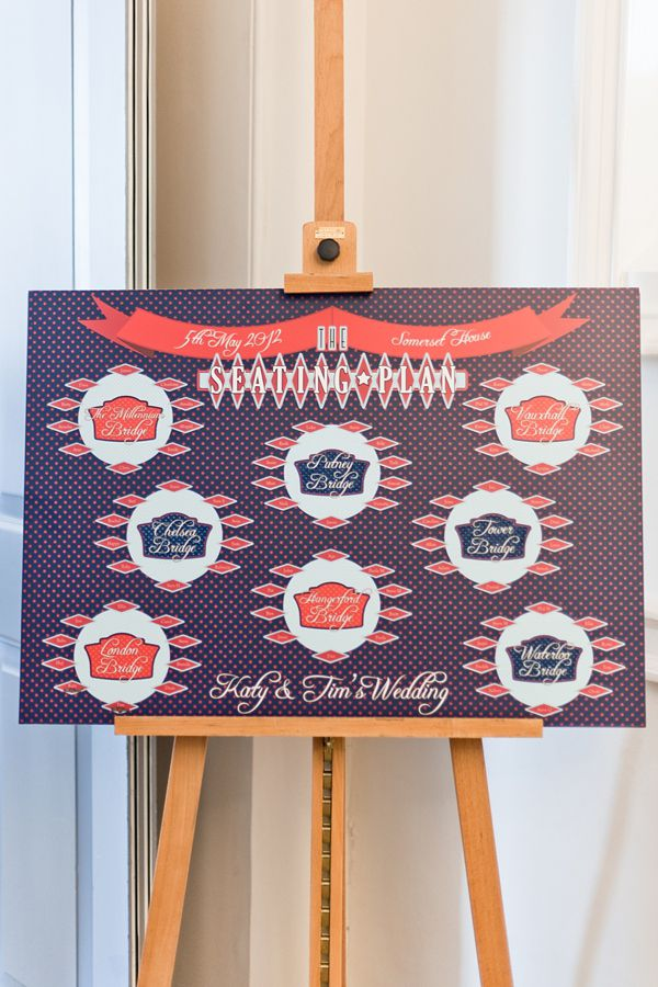 A red, white and blue River Thames themed table plan. Photography by www.anushe.com
