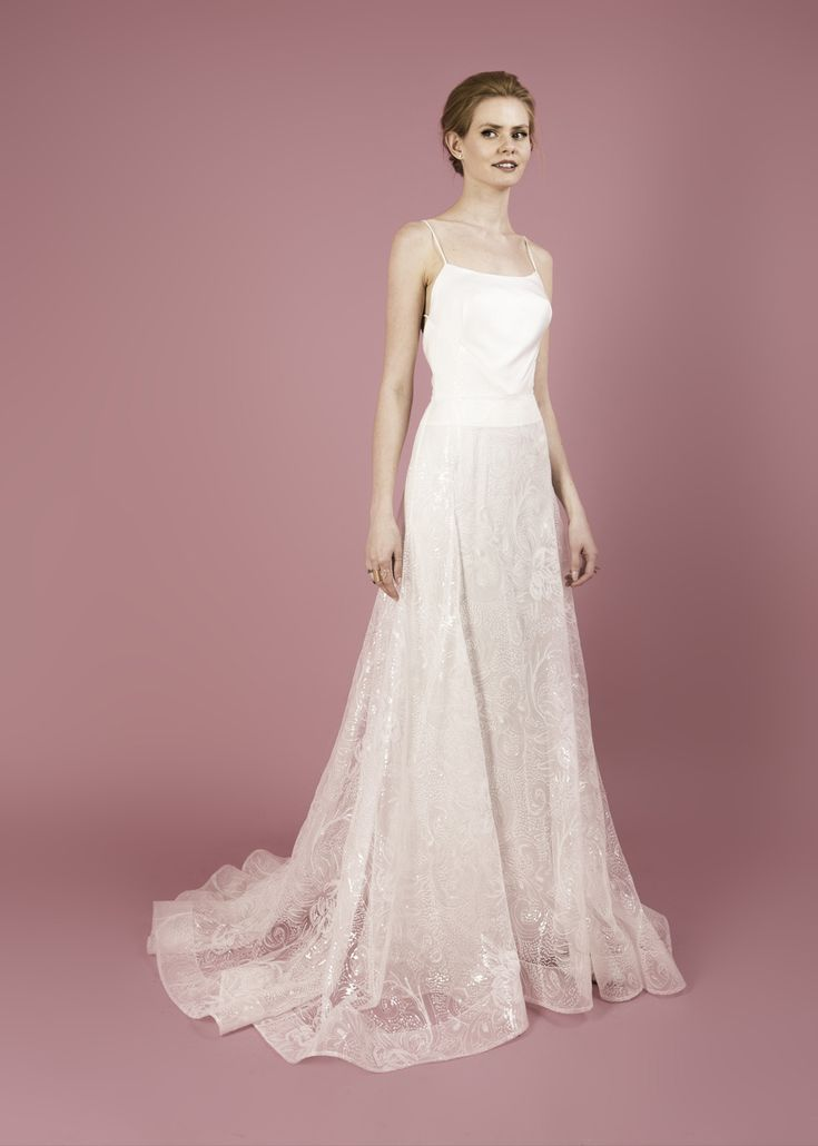 Modern wedding dress for the contemporary bride. Nathalie dress. Gown with full skirt in flower sequin tulle and fitted bodice.