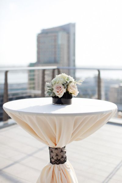 Pale pink and black lace cocktail table.