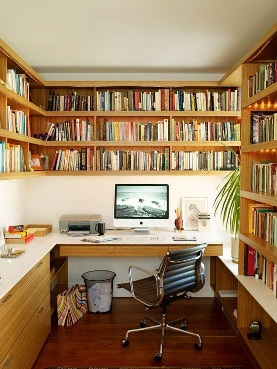 """mini-library-office From the book: """"The strong lines of these horizontal wraparound bamboo shelves make this compact office seem wider than it actually is, while keeping masses of books organized."""