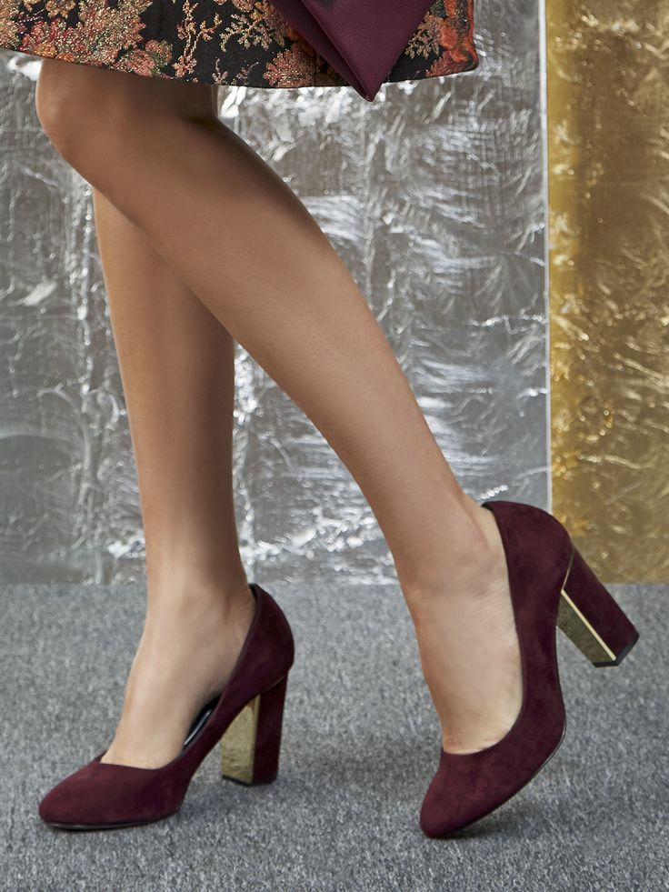 Eggplant suede pumps with stunning gold metallic details on the block heels. Definitely a head-turner for the holiday party season!