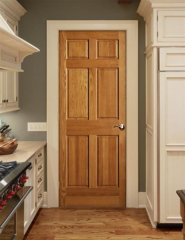 Oak doors, cream trim.  Love the kitchen color + cabinets.