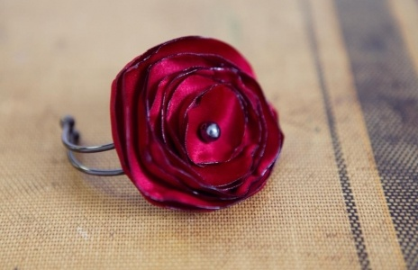 Red satin fabric flower corsage from Mark the Occasion Designs - Milwaukee Florist Alternative