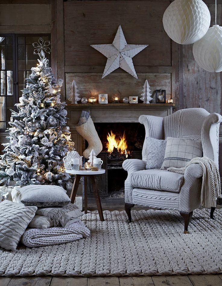 Cozy Christmas. I love this room. Most of all I love the dove gray horizontal braided rug. So great!