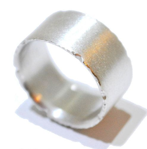 Featuring crumpled and textured edges resembling a leaf this sterling silver ring has an elegant satin finish that almost glitters rather than a mirrored polish, this suits the organic simplicity of the design and delicately sits on the finger.