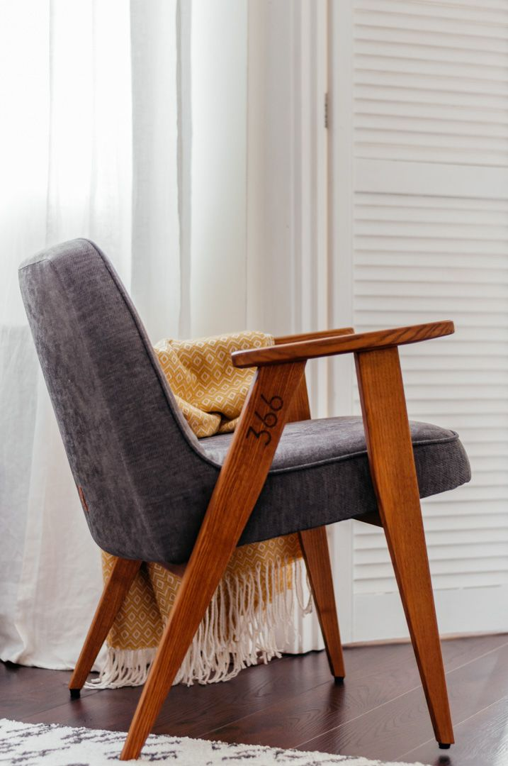 The perfect mid-century armchair for small rooms - Boreal Abode. The stunning 366 chair by 366 Concept. An original mid-century design from Poland. In grey fabric with oak-finish ash wood. With West Elm blanket and IKEA rug.