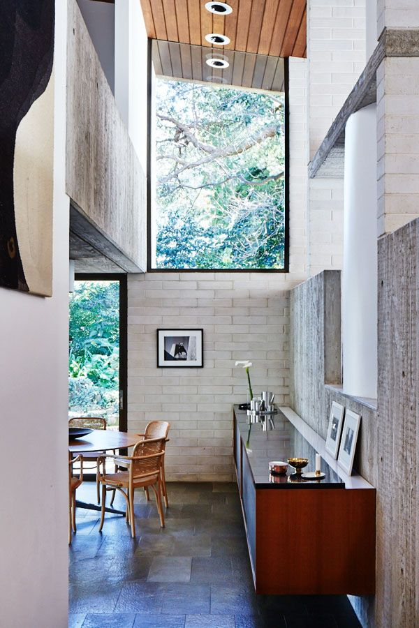 Dining room – with amazing double height ceiling and beautiful views to the leafy exterior! Florence Knoll Oak dining table, Thonet Hoffman dining chairs, original fixed cabinetry to right. Photo - Sean Fennessy, production – Lucy Feagins / The Design Files.