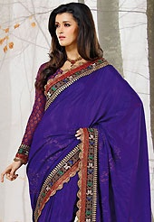 A desire that evokes a sense of belonging with a striking details. This dark purple raw silk saree have beautiful embroidery patch work which is embellished with resham, zari, sequins and lace work. Fabulous designed embroidery gives you an ethnic look and increasing your beauty. Matching viscose blouse is available. Slight Color variations are possible due to differing screen and photograph resolutions.