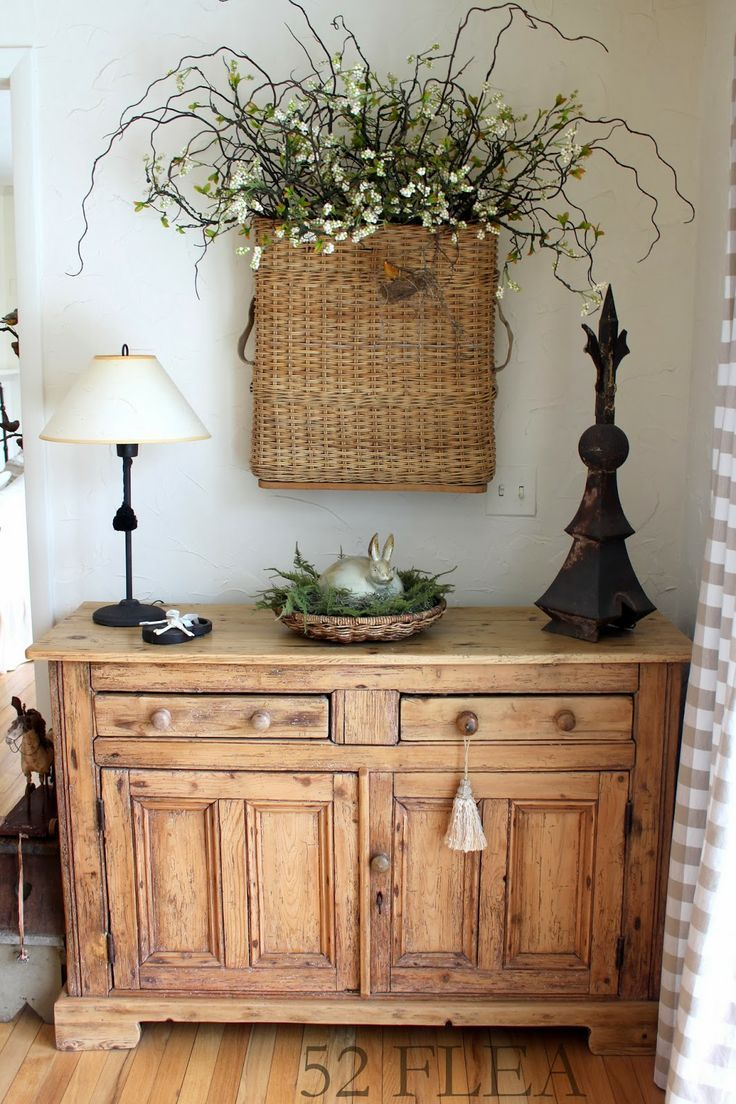 Love the scrubbed pine cabinet.  Love the basket above it even more which would be pretty easy to DIY.