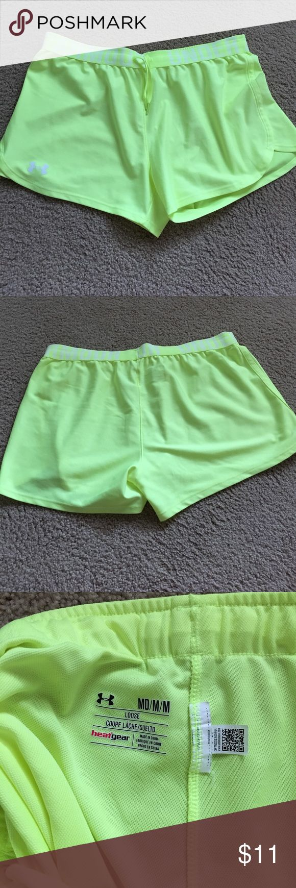 Like new neon yellow under armour shorts 💛 Like new no signs of wear! Heat gear Under Armour Shorts