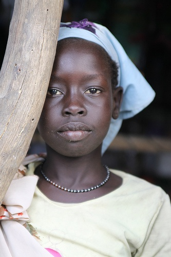 young girl with blue headwrap