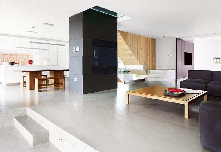 living area and open plan kitchen diner with polished concrete floor and central…