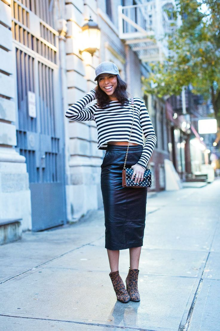 Great mix of classic staples: stripe top, leather skirt and leopard boots. Baseball cap is a bonus!