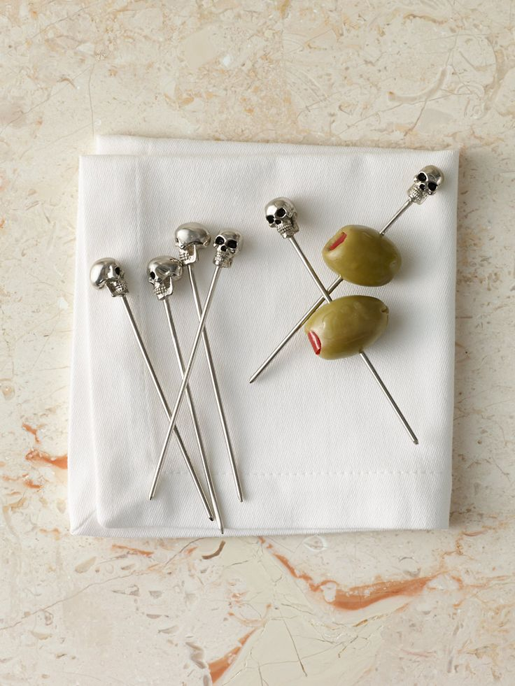 The most adorable tiny skull cocktail picks