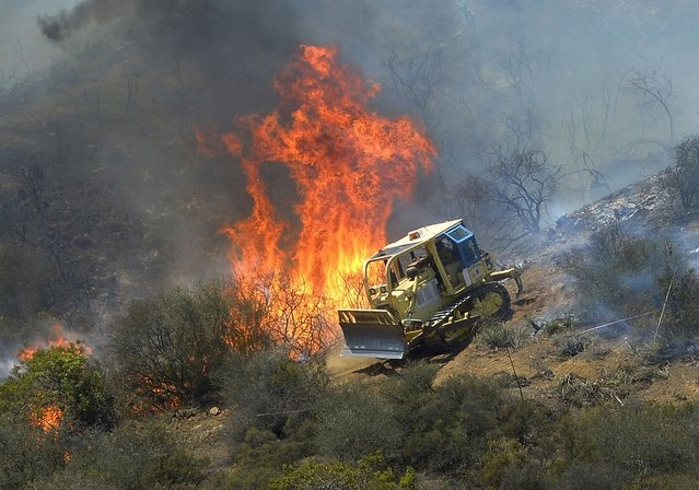Image result for bulldozer and fire break images