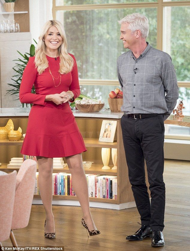 Beautiful: Holly Willoughby looked simply stunning on Monday as she teamed up with her Thi...