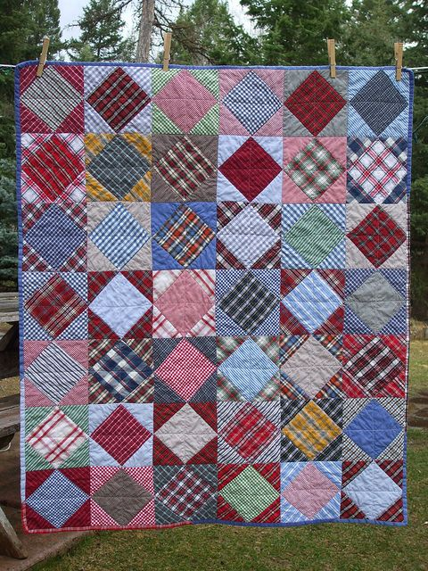 Pieced entirely of 2nd hand dress shirts and a piece of leftover quilt batting from another project.  Donated to the silent auction at the annual fundraiser for our local creative arts center.  Purchased by a local woman for her grandbaby boy.