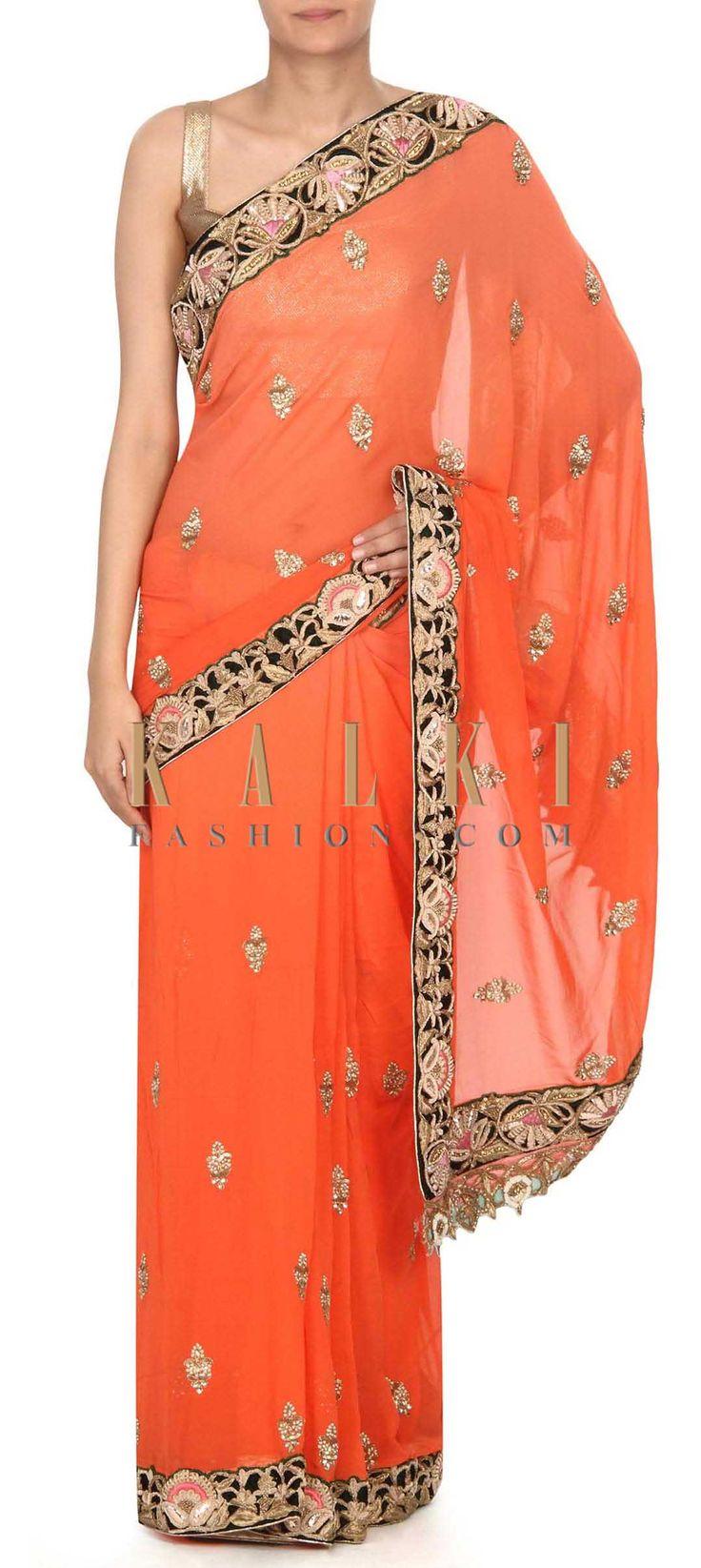 Buy this Peach saree with zardosi embellished border only on Kalki
