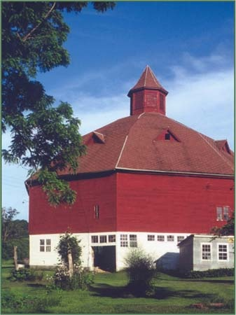 FARMHOUSE – BARN – vintage early american barn commonly used for storing farm equipment, storage of harvested crops, or providing shelter for livestock, an octagon barn.