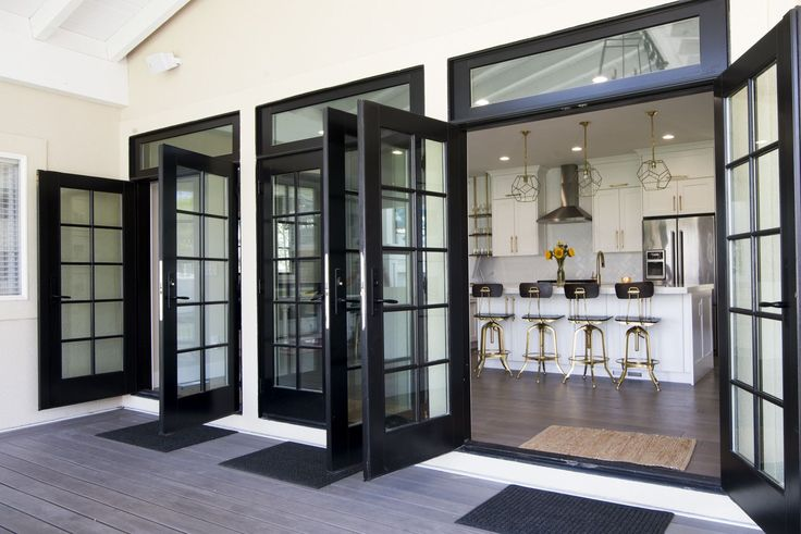 Triple french doors off the kitchen open up to let the outdoors in. Patio porch deck ideas. Home decor. black french doors