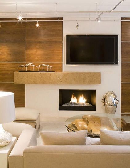 Limestone. This clean and timeless stone is perfect for a contemporary environment. The thickness of this mantel and its asymmetrical placement provide just the right balance for the fireplace and the space. Design tip: Limestone comes in many different types and styles — and some are much more cost effective than others. Ask a designer or do your research carefully before settling on a slab.