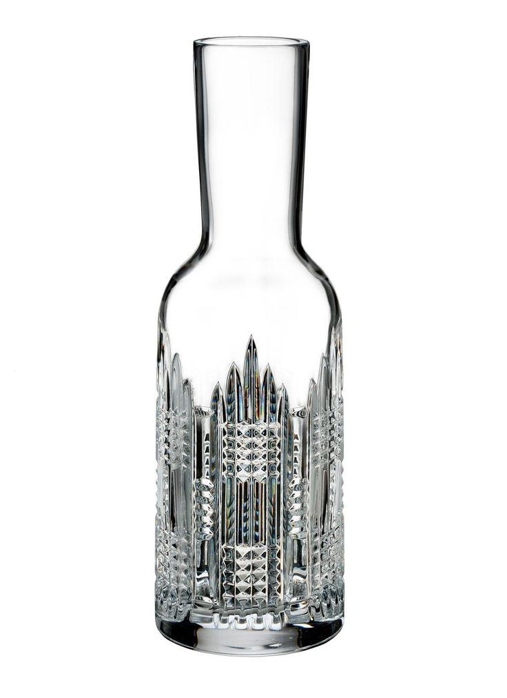 Waterford Crystal Dungarvan Carafe: Serve your favorite wine or beverage to your guests in the Essentially Dungarvan Carafe by Waterford Crystal. Combining the 1950's original design with a contemporary twist has resulted in the striking pattern on this stunning carafe. Signature vertical cutting to create an eye-catching piece. Gift-boxed to create a covetable Irish gift for a fashionable friend. #decanter #carafe #waterfordcrystal #irishdesign #barware #drinkware #drinks #irishgifts
