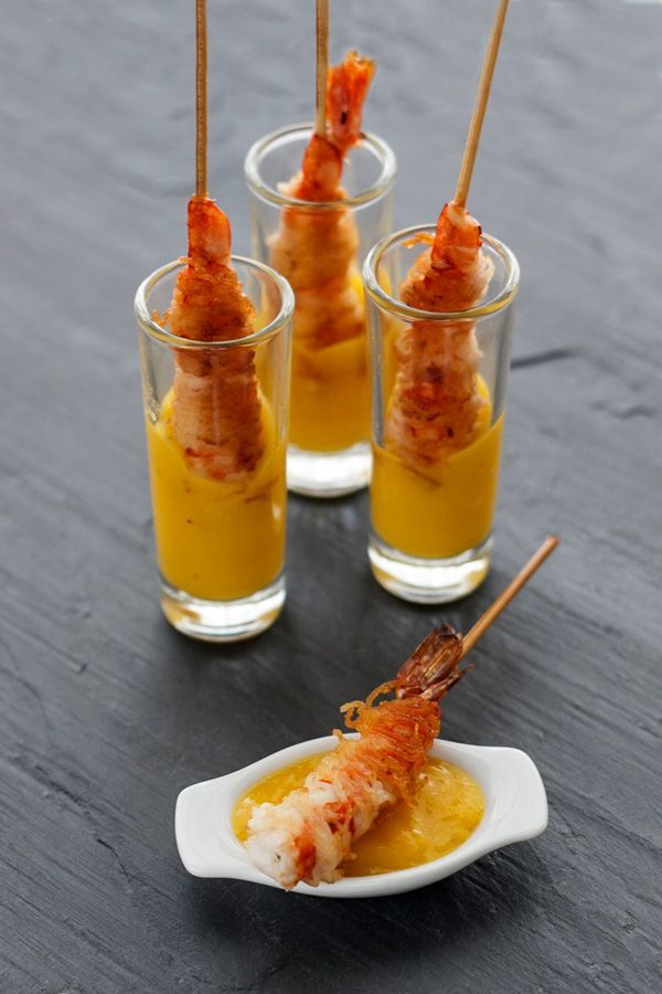 Coconut shrimp served in a shot glass with dipping sauce #catering #appetizers #foodpresentation