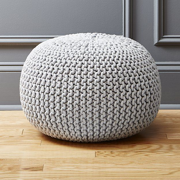 Shop Knitted Pouf Silver Grey.  Accent round layers on sweater vibes in chunky hand-knit silvery grey.  Dense pellet fill is substantial for seat/ottoman duty.