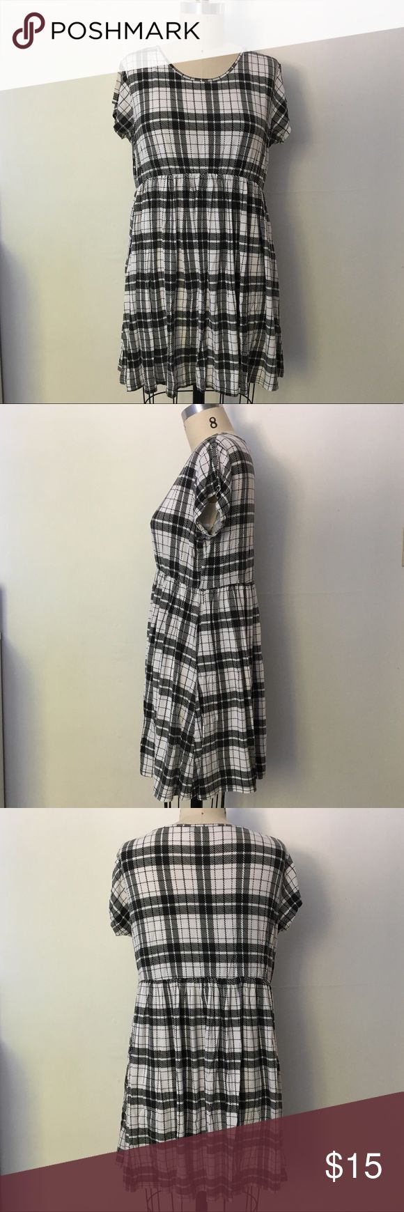 Black and white plaid dress Super comfy plaid mini dress with cinched empire waist. Perfect for weekends and lounging. 95% viscose, 5% elastane. ASOS Dresses Mini