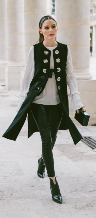Olivia Palermo in black ZARA vest at Paris fashion week