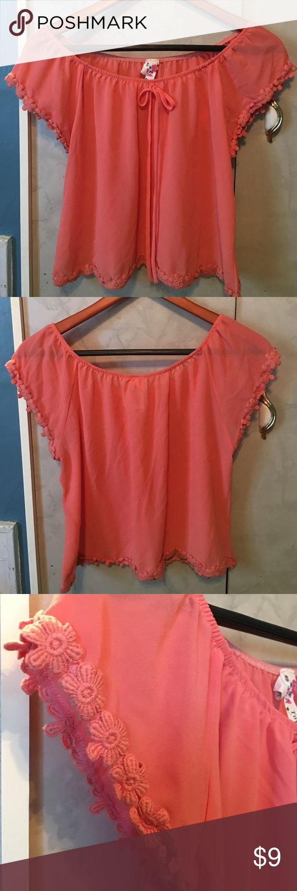 Pink/Peach Top Flowers on Hem and Sleeves . Worn a Few Times but well kept . Tops Crop Tops