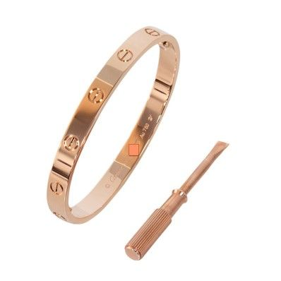 This Cartier Love Bracelet in rose gold is a classic, highly coveted Love bracelet by prestigious jeweler Cartier. This beautiful bracelet is a signature Cartier piece, and can be worn day and night.