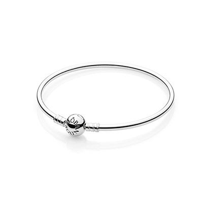 The stunning new PANDORA Bangle in Sterling Silver. Wear it on its own for a contemporary and minimalistic look or add charms to make it uniquely yours.