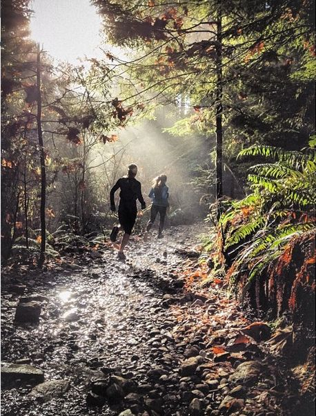 We can aim for something like this for a trail running shot of both models- but have them coming toward the camera, and closer. I like the light through the trees:)