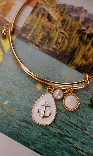 Anchor charm on an infinity band; you can't go wrong with this bracelet. With love as your anchor, you'll weather the storms. Celebrate summ...
