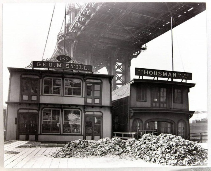 1937 Oyster House, South Street, under Manhattan Bridge, with pile of oyster shells