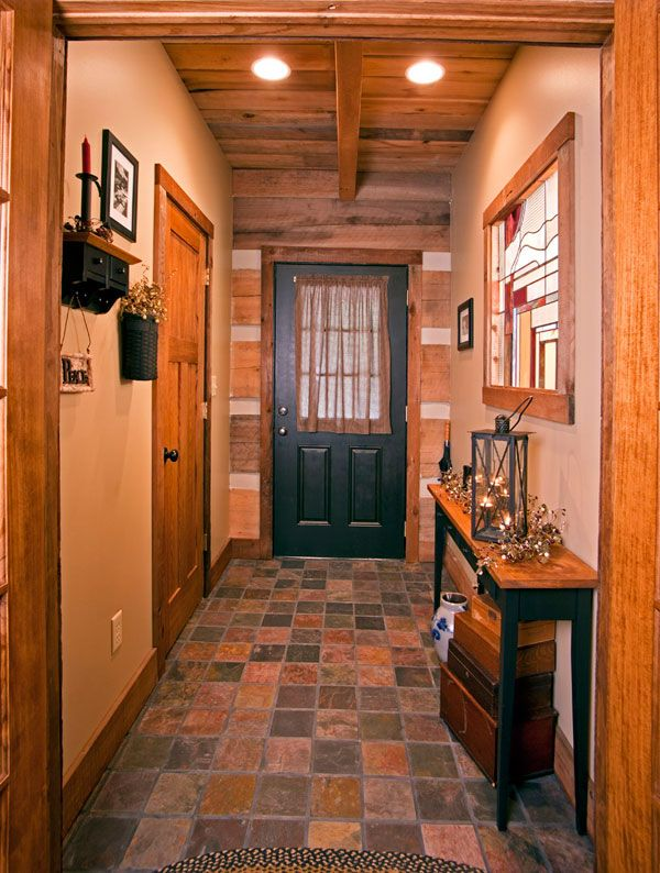 The front entry is tiled in slate with a palette to complement the stained-glass panel on the right.