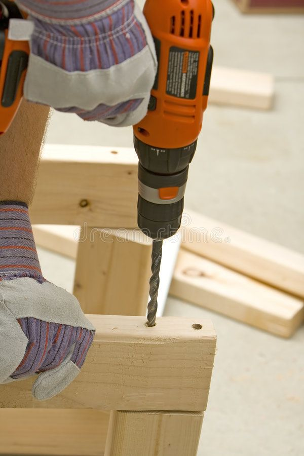 Drilling Hole Man Drilling A Hole Into Wood With Cordless Drill Sponsored Man Hole Drilling Drilling Drill A Drill Drilling Holes Cordless Drill